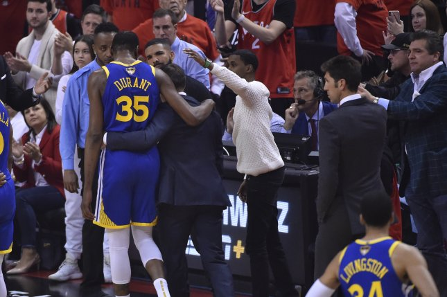 Golden State Warriors forward Kevin Durant (L) re-aggravated his lower right leg injury during Game 5 of the NBA Finals. Photo by Warren Toda/EPA-EFE
