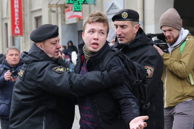 Police officers detain journalist Roman Protasevich attempting to cover a rally in Minsk, Belarus, in 2017. File Photo by EPA-EFE