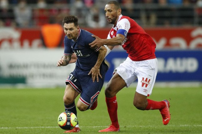 Paris Saint-Germain's Lionel Messi (L) did not attempt a shot in his debut for the French Ligue 1 team Sunday in Reims, France. Photo by Yoan Valat/EPA-EFE
