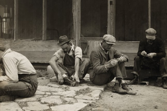 A group of Texas tenant farmers who have been displaced from their land by tractor farming ca. July 1937. File Photo by Dorothea Lange/Library of Congress
