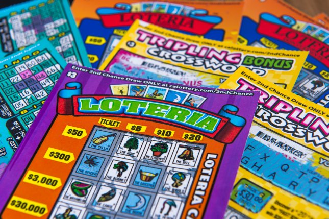 A Saskatchewan said a scratch-off lottery ticket she bought in December to give away as a Christmas gift instead spent months in a drawer before she discovered it was a $740,000 winner. File Photo by Pung/Shutterstock.com