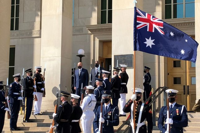 Australian Defense Minister Peter Dutton and Secretary of Defense Lloyd Austin stand at attention for the national anthems of the two nations before meetings at the Pentagon on Wednesday. Photo by Jim Garamone/Department of Defense