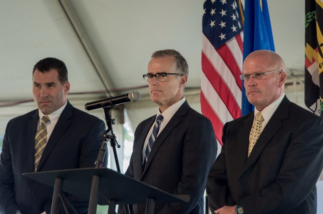 Former FBI Deputy Director Andrew McCabe (center) was fired late Friday night by U.S. Attorney General Jeff Sessions, just over 24 hours before McCabe was to become eligible for full pension benefits and was expected to retire. File photo by UPI