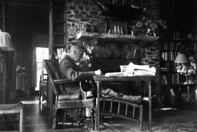 President Franklin D. Roosevelt works near the hearth at the Little White House in Warm Springs, Ga. This photo was taken by his friend, Margaret Daisy Suckley, a few days before he died on April 12, 1945. File Photo courtesy FDR Presidential Library