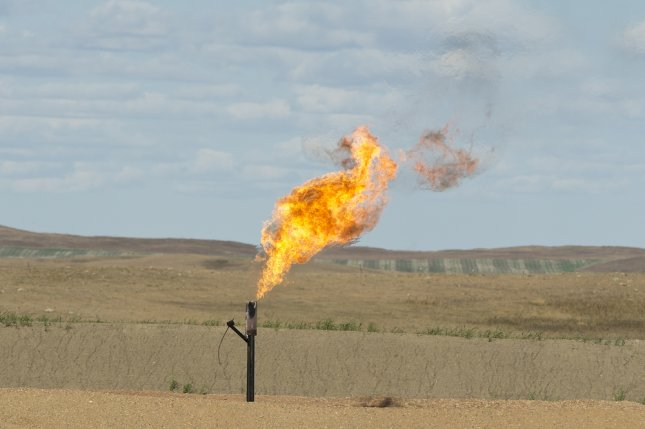 A natural gas flare in North Dakota. A federal court ruled Monday that the Environmental Protection Agency must enforce a methane pollution rule dating to the Obama administration. Photo by Steve Oehlenschlager/Shutterstock