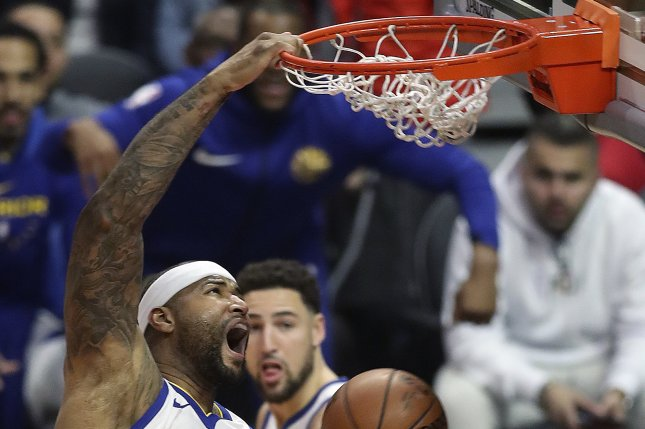68aa81598 Golden State Warriors center DeMarcus Cousins (C) dunks the ball in the  first half of the NBA basketball game between the Golden State Warriors and  the Los ...