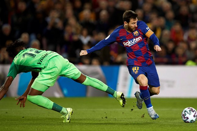 Barcelona striker Lionel Messi (R) increased his Copa del Rey scoring total to two goals after scoring twice in a round of 16 win against Leganes Thursday in Barcelona. Photo by Alejandro Garcia/UPI