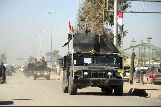 Iraqi security forces mobilize February 19 at Mosul, where the battle is still raging. Photo by EPA