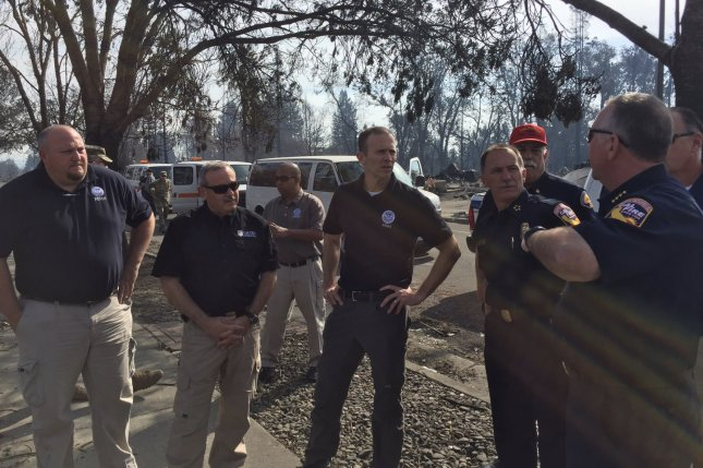 Federal Emergency Management Agency Director Brock Long (C) speaks with local and state emergency officials in California on October 18, 2017. File Photo courtesy FEMA