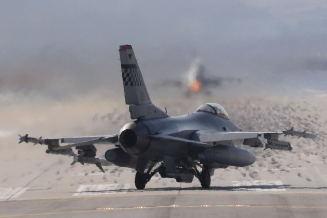 A U.S. F-16 fighter takes off from Osan Air Base, south of Seoul, on Monday amid heightened tensions raised by North Korea's launch of four ballistic missiles. Photo by Yonhap News Agency/UPI