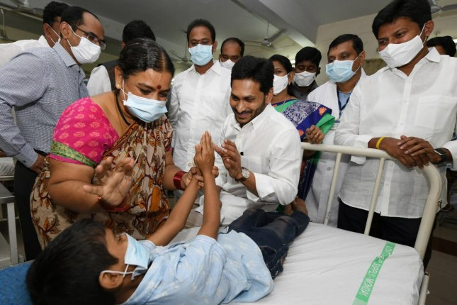 Andhra Pradesh Chief Minister Y.S. Jagan Mohan Reddy (C) meets with patients being treated for an unknown disease in Eluru town, Andhra Pradesh, India. Photo by Stringer/EPA-EFE/Handout