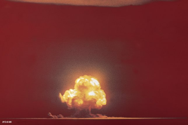 U.S. officials conduct the Trinity nuclear test in central New Mexico on July 16, 1945. This is the only color image in existence that shows the explosion, and was taken by Jack Aeby from a camp about 10 miles away. Photo courtesy Los Alamos National Laboratory