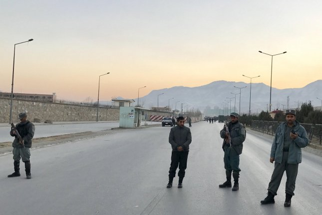 Afghan security officials block a road to Parliament after twin suicide bombings targeting the Parliament building complex in Kabul on Tuesday. At least 21 people died. Photo by Hedayatullah Amid/European Pressphoto Agency