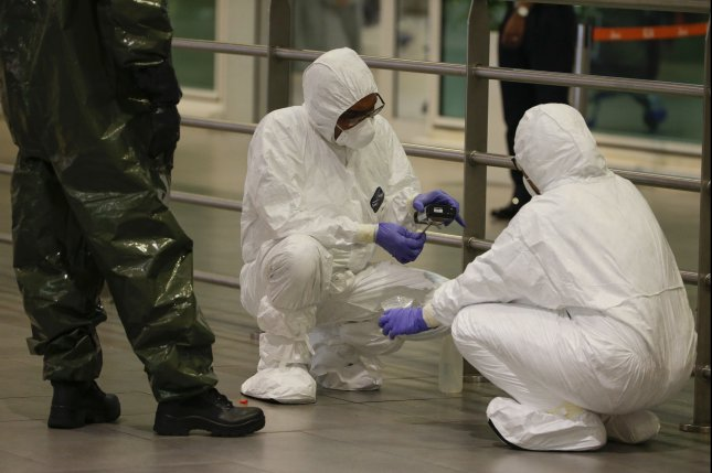 A hazmat team conducts checks inside Kuala Lumpur Internatinal Airport at Sepang, Malaysia, on Sunday. North Korean defectors who have spoken out against the Kim Jong Un regime fear risks, according to a prominent defector. Photo by Fazry Ismail/EPA