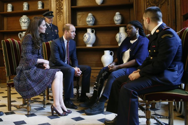 Britain's Prince William and his wife his wife Kate Middleton, the Duchess of Cambridge, spoke with survivors of the attacks in Bataclan and Nice during a visit to Les Invalides military hospital in Paris during their two-day trip to France. Photo by Gonzalo Fuentes/EPA