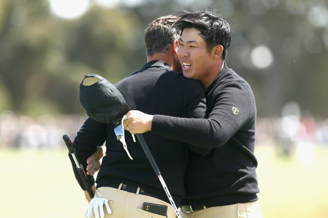 Australian Adam Scott (L) and Byeong-Hun An (L) of South Korea beat Tony Finau and Bryson DeChambeau in the first round of the Presidents Cup golf tournament Thursday at Royal Melbourne Golf Club in Melbourne, Australia. Photo by Scott Barbour/EPA-EFE