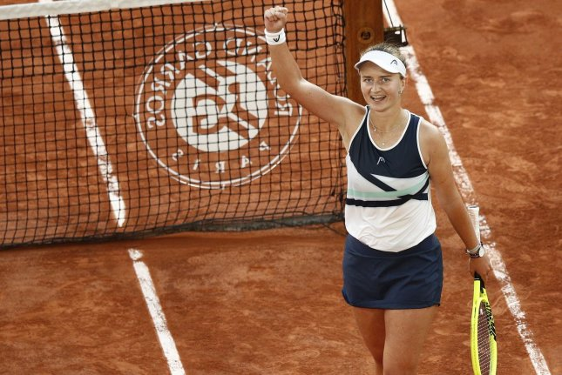 Barbora Krejcikova of the Czech Republic celebrates after beating Maria Sakkari of Greece during the French Open semifinals Thursday at Roland Garros in Paris. Photo by Yoan Valat/EPA-EFE