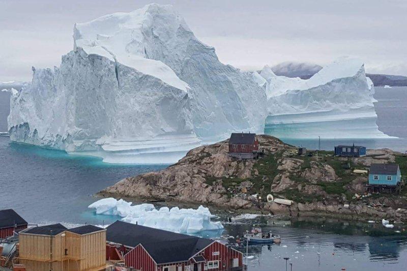 A large iceberg is seen near the village of Innaarsuit, in Avannaata municipality, northwestern Greenland, on July 12, 2018. File Photo by Magnus Kristensen/EPA-EFE