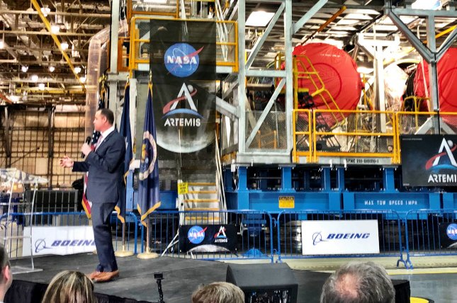 NASA Administrator Jim Bridenstine addresses a crowd in front of the new core stage of the Space Launch System  rocket for the Artemis moon missions on Monday at NASA's Michoud Assembly Facility in Slidell, La. Photo by Paul Brinkmann/UPI
