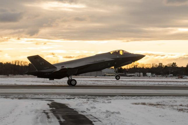 A pilot assigned to the 134th Fighter Squadron, Vermont Air National Guard, lands a F-35 Lightning II aircraft at the Vermont Air National Guard Base in Vermont Dec. 5. Photo by Julie M. Shea/U.S. Air National Guard