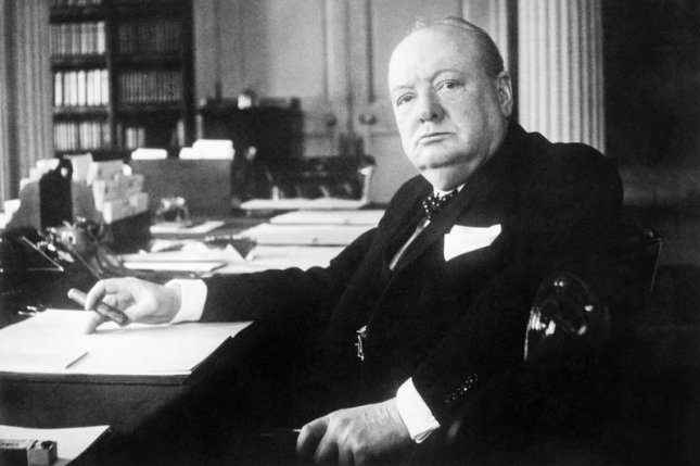 Portrait of Prime Minister Winston Churchill at his seat in the Cabinet Room at No. 10 Downing Street, London ca. File Photo courtesy Cecil Beaton/Imperial War Museums