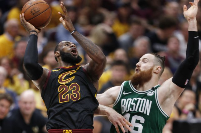 LeBron James (L) of the Cleveland Cavaliers gets a shot off against Boston Celtics center Aron Baynes (R) of Australia during the second half of Game 3 of the Eastern Conference finals Saturday at Quicken Loans Arena in Cleveland, Ohio. Photo by David Maxwell/EPA-EFE/Shutterstock