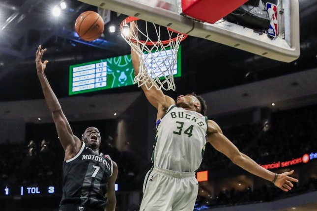 Milwaukee Bucks forward Giannis Antetokounmpo (34) blocks a shot by Detroit Pistons big man Thon Maker. Antetokounmpo becomes the second player in Bucks history to win the NBA's Defensive Player of the Year Award. File Photo by Tannen Maury/EPA-EFE