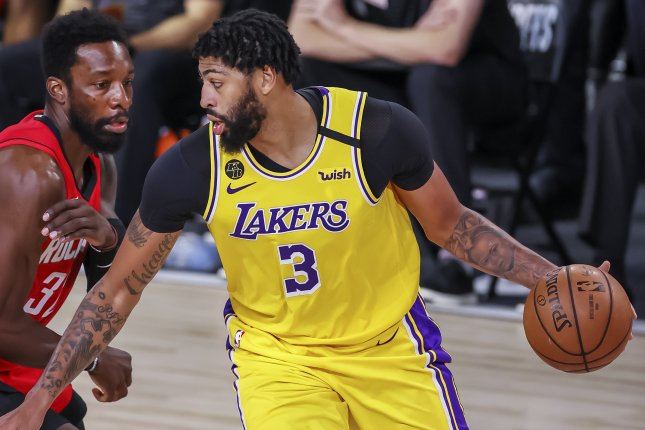 Los Angeles Lakers forward Anthony Davis (R) used his dynamic offensive skill set and physical defense in a playoff win over the Houston Rockets Thursday in Orlando, Fla. Photo by Erik S. Lesser/EPA-EFE