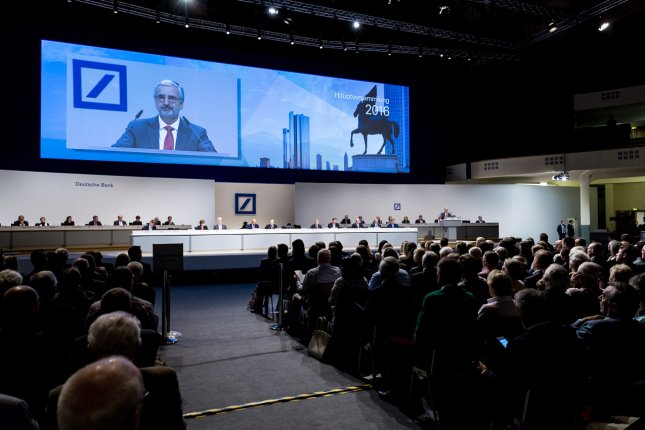 Officials speak at the general meeting of German Deutsche Bank AG in Frankfurt, Germany. Deutsche Bank stock rallied Friday despite mounting legal woes in Germany, Italy and the United States. Photo courtesy Deutsche Bank AG