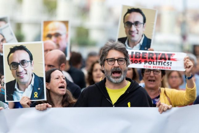 Activists protest Monday in Barcelona, Catalonia, Spain, to oppose sentences given to nine Catalan separatists who supported efforts two years ago to secede from Spain. Photo by Enric Fotcuberta/EPA-EFE