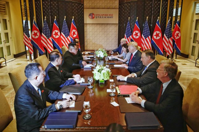 U.S. President Donald Trump (3-R) and North Korean leader Kim Jong Un (3-L) look at each other during the expanded bilateral meeting as part of the historic summit at the Capella Hotel on Sentosa Island, Singapore. Photo by Kevin Lim/EPA-EFE/THE STRAITS TIMES