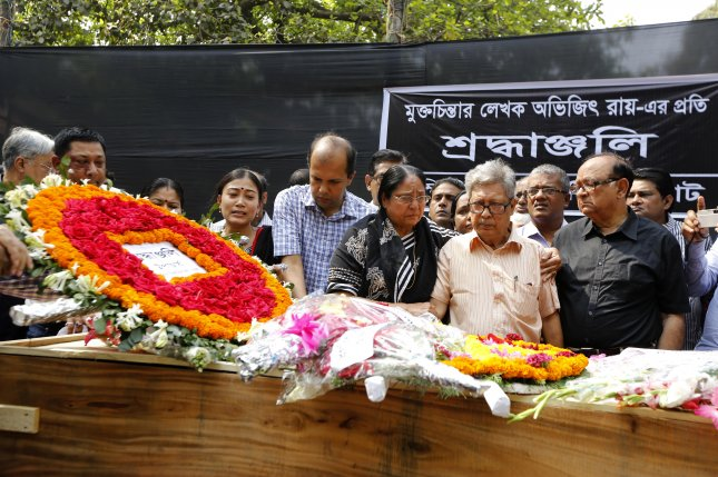 Teachers, students and people from all walks of life pay tribute with flowers March 1, 2015, to Bangladeshi blogger Avijit Roy. Police in Bangladesh on Sunday arrested a man in connection with the killing. File Photo by Abir Abdullah/EPA