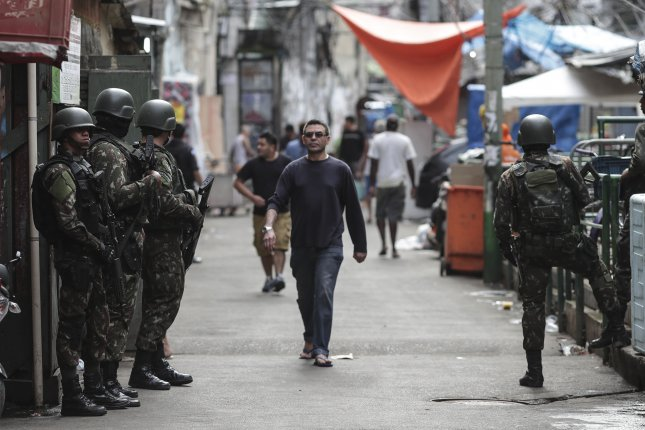 Soldiers stand on guard in a street on June 9 during a military operation in a district of Rio de Janeiro, Brazil. File Photo by EPA-EFE/Antonio Lacerda