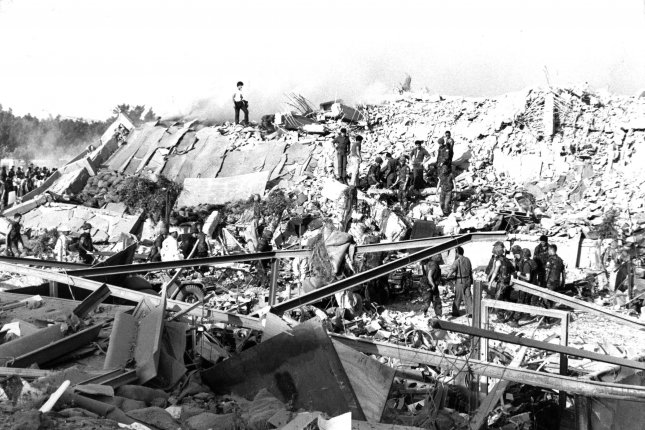 Service members pick through the rubble after the bombing of the Marine barracks in Beirut, Lebanon, on Oct. 23, 1983. Family members of 241 Marines killed in the attack can collect nearly $2 billion in Iranian funds, the U.S. Supreme Court ruled. File photo courtesy of U.S. Marine Corps