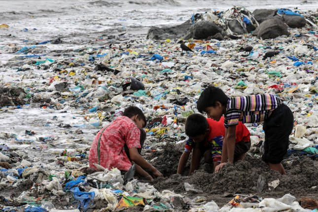 Children play in a large collection of plastic waste at Mahim Beach in Mumbai, India. The study released Monday cited hundreds of thousands of pieces of plastic waste, mostly in Southern Hemisphere nations. File Photo by Divyakant Solanki/EPA-EFE
