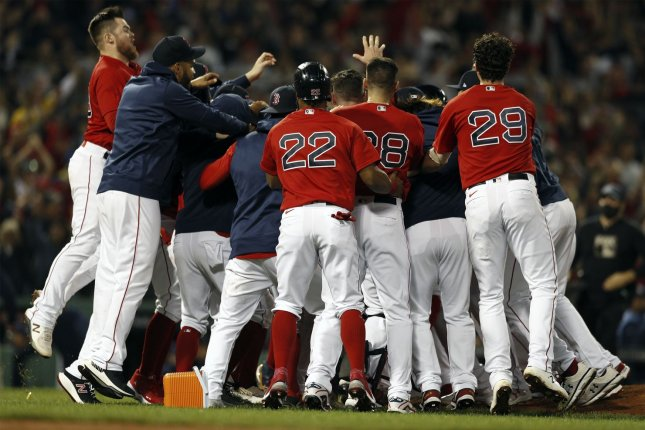 Red Sox beat Rays, reach ALCS; Braves knock off Brewers for 2-1 lead in NLDS