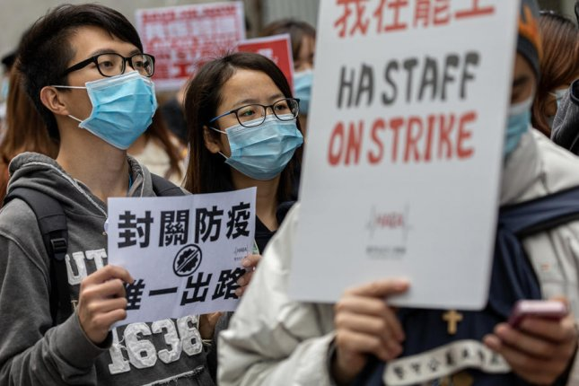 Hong Kong imposed a mandatory 14-day quarantine on all arrivals from mainland China after striking hospital workers demanded that border crossings be closed to help contain the novel coronavirus outbreak. Photo by Jerome Favre/EPA-EFE