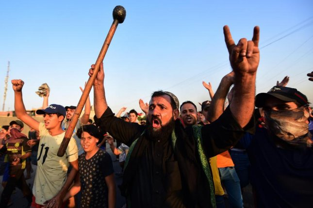 Iraqis protest in east Baghdad over a lack of jobs, shoddy water and electricity infrastructure and other problems. Photo by Murtaja Lateef/EPA-EFE