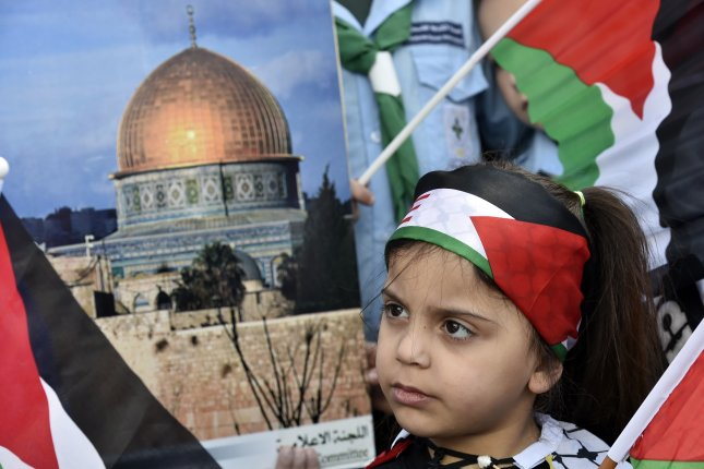 A Palestinian girl with a national flag on her head attends a protest against the so-called deal of the century from U.S. President Donald Trump to solve the conflict between Palestinians and Israel, in Bourj al-Barajneh Palestinian refugee camp, in the southern suburb of Beirut, Lebanon, on January 31. File Photo by Wael Hamzeh/EPA-EFE