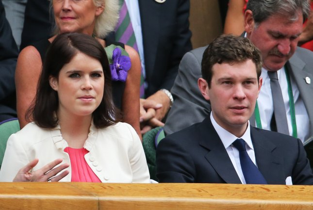 Princess Eugenie (C) and Jack Brooksbank (R) attend the Wimbledon tennis championships on July 5, 2014. New details about their wedding were released Friday. File Photo by Tatyana Zenkovich/EPA