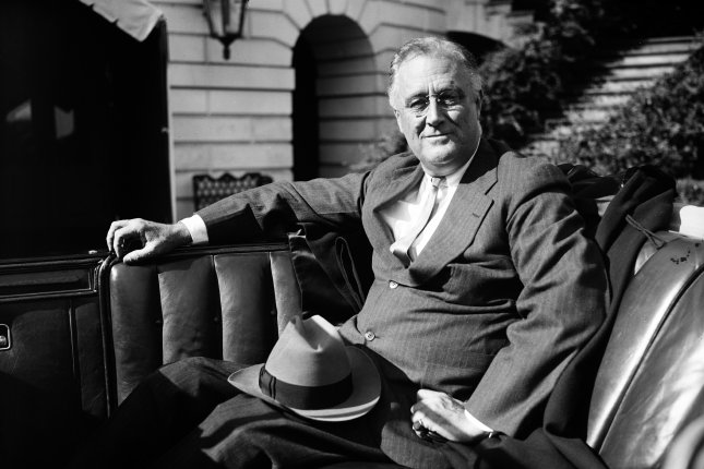 President Franklin Roosevelt waiting in his car outside the White House ca. 1936. On February 5, 1937, Roosevelt proposed expanding the Supreme Court to up to 15 justices. File Photo by Library of Congress