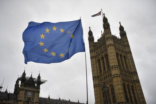 An EU flag is seen outside British Parliament in London. Trade talks between EU and British negotiators are scheduled to resume in London in the coming days. File Photo by Neil Hall/EPA-EFE