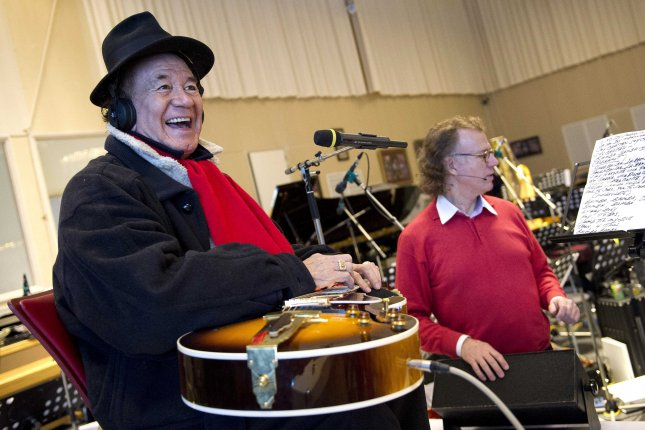 Trini Lopez (L) rehearses with Dutch violist and conductor Andre Rieu in Lopez's studio in Maastricht, The Netherlands, on February 22, 2013. Lopez died on Tuesday of complications from COVID-19. Photo by Marcel Van Hoorn/EPA
