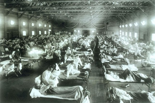 Patients sick with the Spanish flu are hospitalized at a makeshift ward at Camp Funston, Kansas, in 1918. File Photo courtesy of the U.S. Army