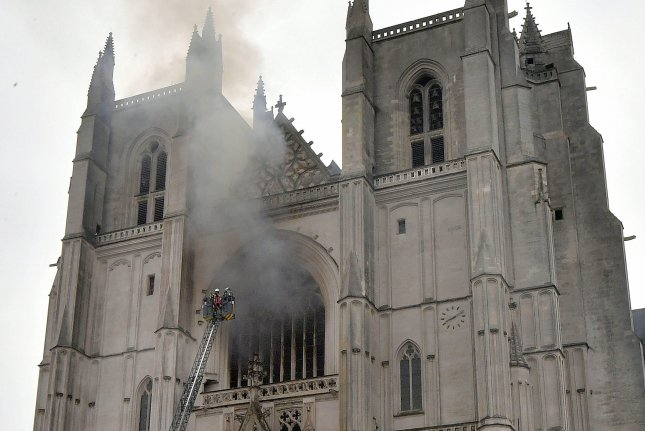 Firefighters work to extinguish the blaze at the Saint Peter and Saint Paul Cathedral in Nantes, France, on Saturday. Photo courtesy of EPA-EFE