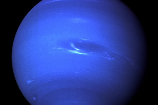 On August 25, 1989, Voyager 2, after a 4 billion-mile journey, made its closest pass over Neptune, sending back images of southern lights and its moon, Triton, to Earth. File Photo courtesy of NASA