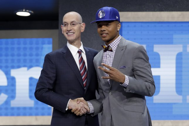 NBA Commissioner Adam Silver (L) shakes hands with Markelle Fultz picked number one by the Philadelphia 76ers in the first round of the 2017 NBA draft at the Barclays Center in Brooklyn, New York, USA, 22 June 2017. Photo by Jason Szenes/EPA