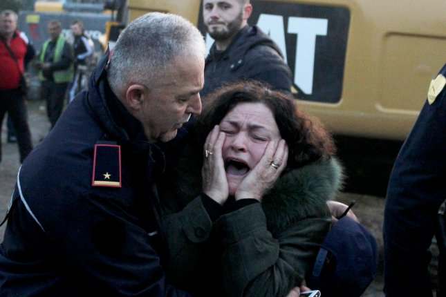 A woman cries as her relatives are trapped in a building after an earthquake hit Thumane, Albania, Tuesday. Photo by Malton Dibra/EPA-EFE