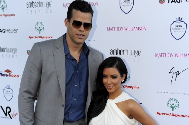 Kim Kardashian (R) and Kris Humphries attend the Amber Lounge fashion show on May 27, 2011. The reality star confessed on Sunday's episode of Watch What Happens Live that she wed Humphries for the wrong reasons. File Photo by Vincent Damourette/EPA