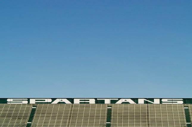 Empty bleachers at Spartan Stadium, home of the Michigan State Spartans college football team. Three football players were dismissed after being charged with sexual assault. File photo by Lori Sparkia/Shutterstock